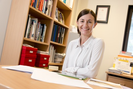 Griffith academic Sharyn Rundle-Thiele sits behind her office desk.