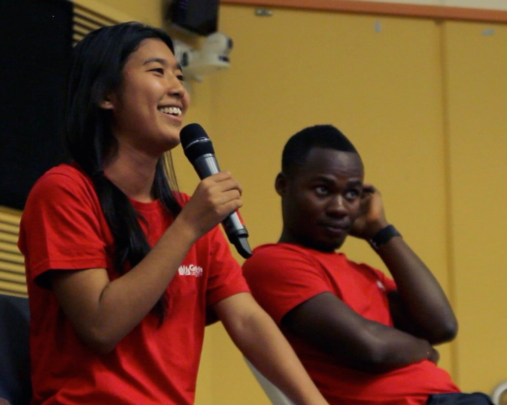 Griffith students Kim and Kiba sharing stories as they promote Refugee Week 2013 at the Logan campus.