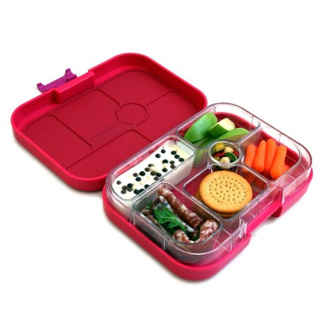 An open, red lunchbox with snack biscuits, carrots, apple and other food.