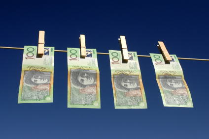 Cash notes pegged to a clothes line.