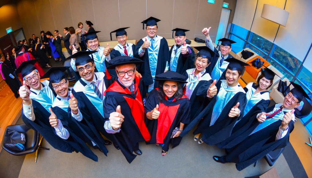 Prof Stephen Billett and A/Prof Sarojni Choy (front centre) with graduates from the MTD program in Singapore