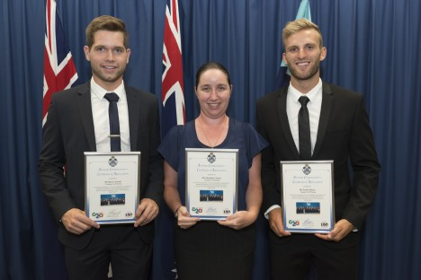 Griffith criminology students Christine Carney, Kasey Swank and Taylor Reeve receive their police awards following their work in the lead up to the G20