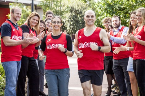 Griffith staff Lara Herrero and Andrew Williams are cheered on by fellow competitors ready to participate in the Gold Coast Airport Marathon.