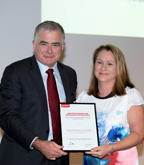 Associate Professor Ruth McPhail accepts the 2015 Vice Chancellor's Award for Griffith University Teacher of the Year from Vice Chancellor Professor Ian O'Connor.