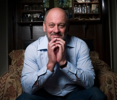 Professor Tim Flannery, sitting in chair, will speak at Griffith University's Nathan campus on Monday, November 30