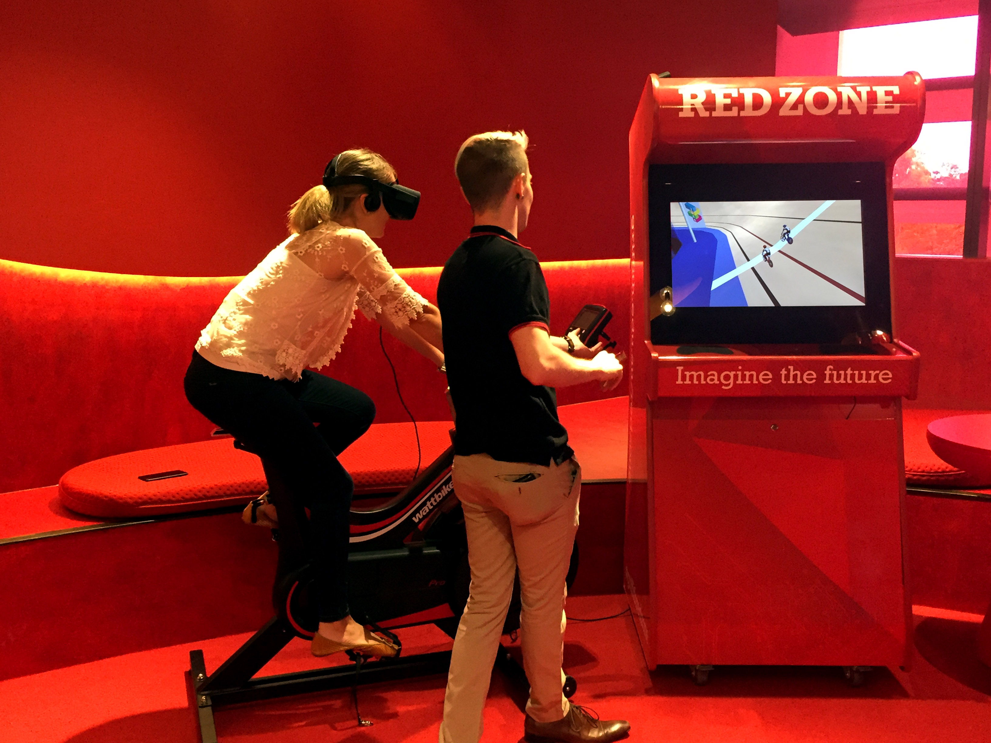 Students test their skill and stamina in the state-of-the-art virtual reality track cycling game at Griffith Red Zone