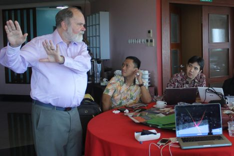 Adjunct Professor Colin Brown presents mentoring principles two seminar participants in Indonesia
