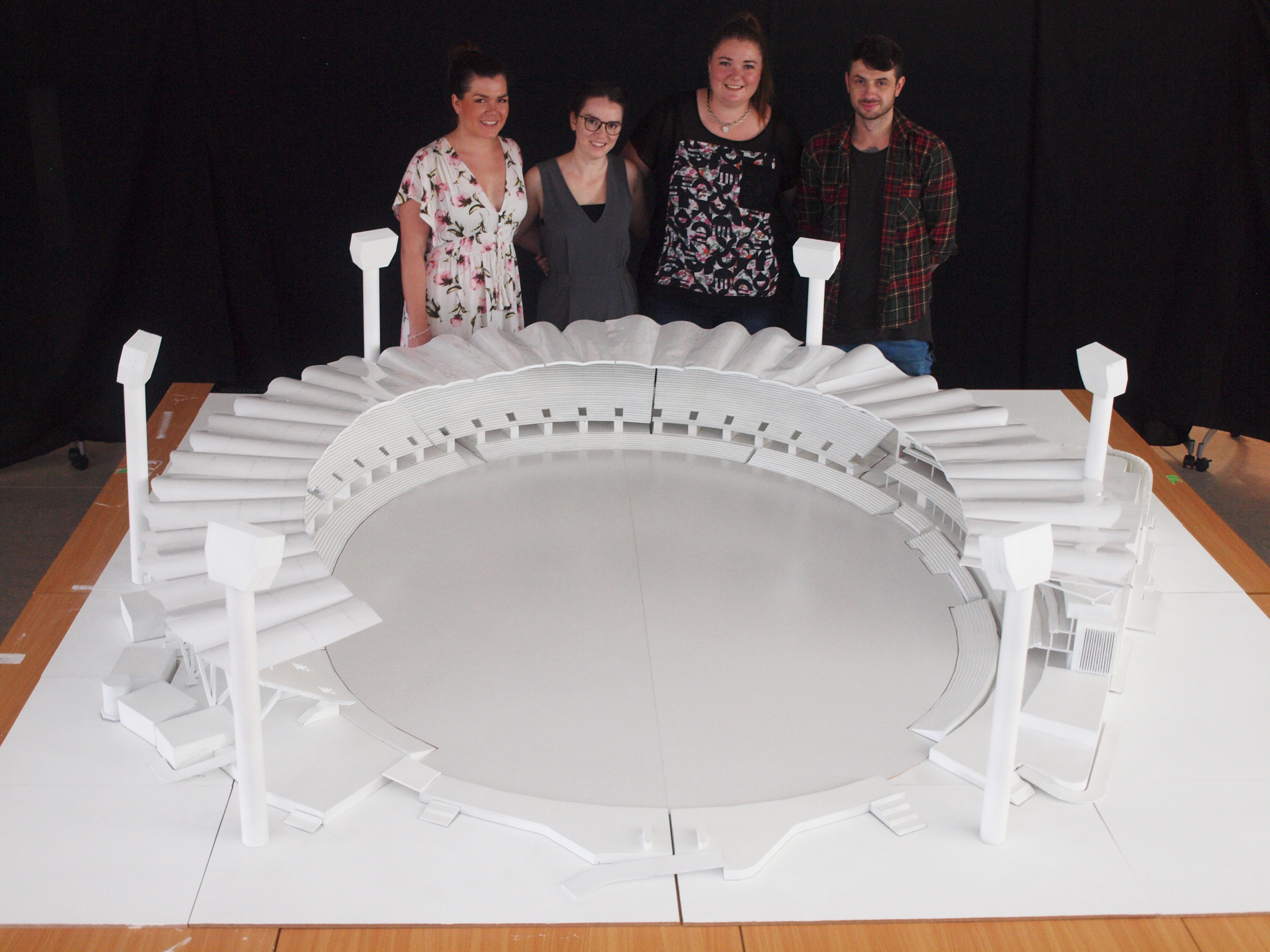 Architecture students Nikki Findlay, Sarah Paige, Kirra Keating, Brian Mates with the Carrara Stadium model.