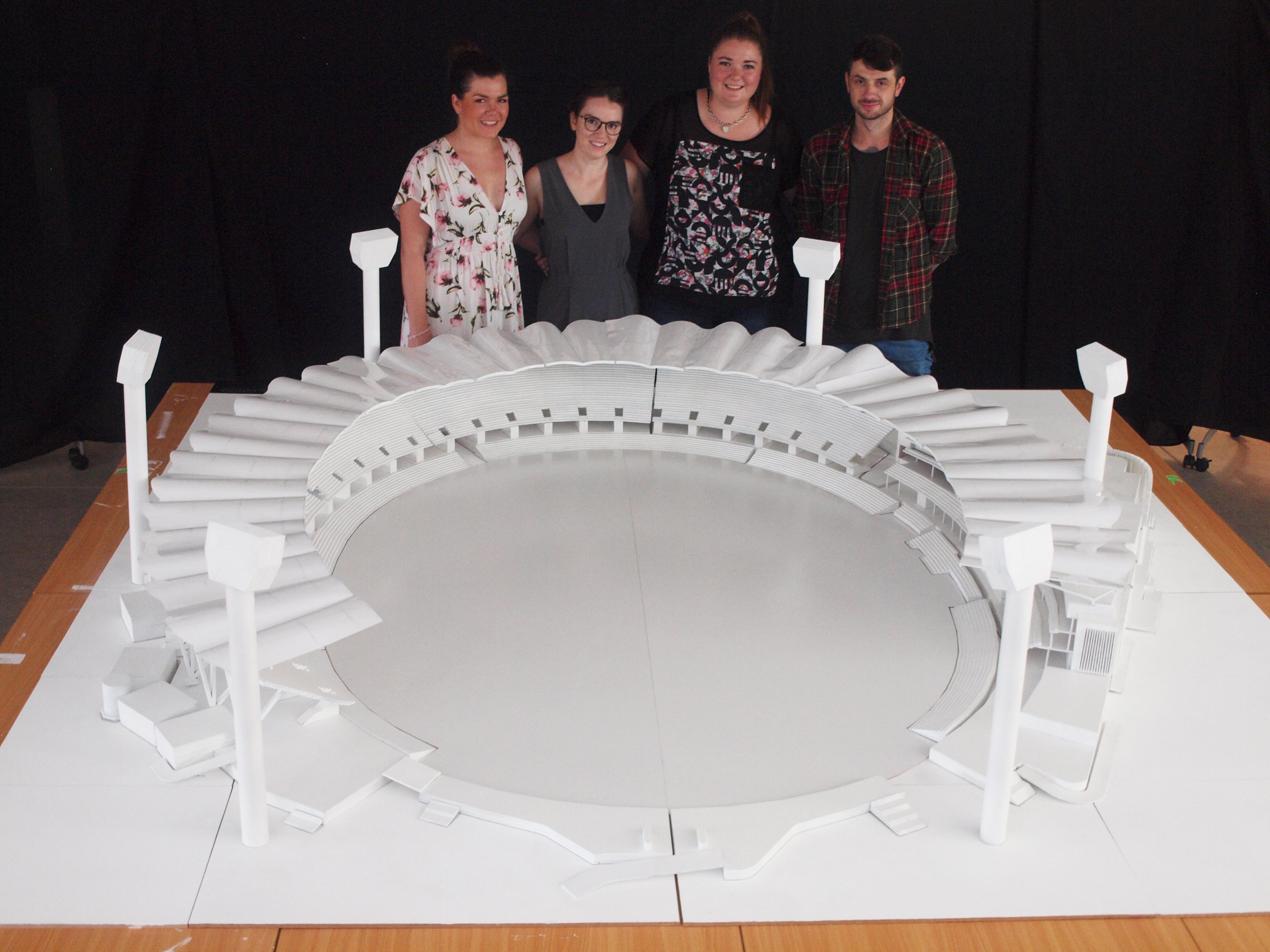 Architecture students Nikki Findlay, Sarah Paige, Kirra Keating, Brian Mates with the Carrara Stadium model.