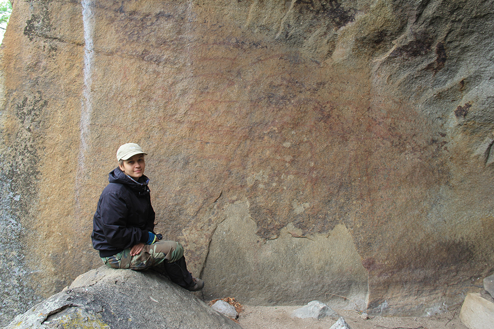 Shaman-Gora rock art site, locality # 1. Irina Ponomareva at the panel with a heard of bison.